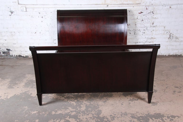 An exceptional dark mahogany modern queen size sleigh bed  By Barbara Barry for Baker Furniture  USA, circa 1990s  Measures: 64.88