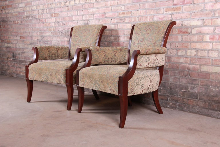 An exceptional pair of modern upholstered club or lounge chairs  By Barbara Barry for Baker Furniture  USA, circa 1990s  Mahogany and upholstery.  Measures: 29.25