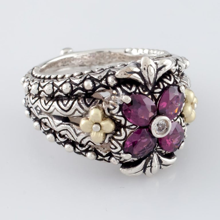 Gorgeous Textured Ring by Barbara Bixby Features Four Oval Cut Rhodolite Garnet in Floret Shape 18k Yellow Gold Accents Total Mass = 14.6 grams Size 7 Gorgeous Piece!