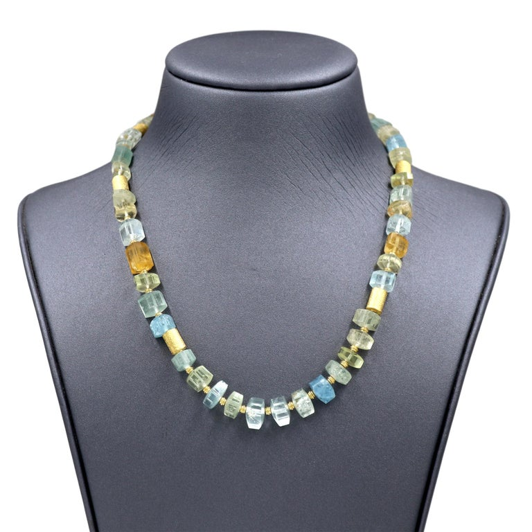 Aquamarine Beryl Crystals Necklace hand-fabricated by award-winning jewelry maker Barbara Heinrich in matte-finished 18k yellow gold featuring a stunning assortment of beryl crystals individually set between high karat yellow gold bead and tube