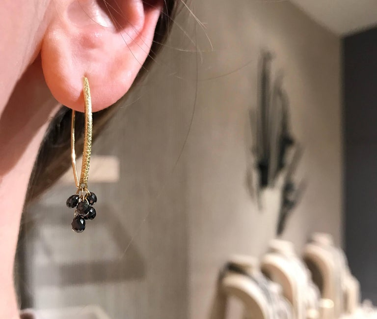 Drop Earrings handcrafted by award-winning jewelry artist Barbara Heinrich in matte-finished 18k yellow gold with 10 faceted black diamond briolettes totaling 2.47 carats and attached by individual dangling 18k yellow gold loops.