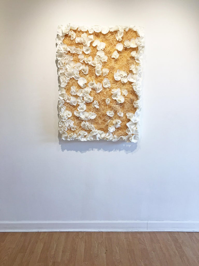'Yesterday, Today, and Tomorrow' 2018 by American artist Barbara Hirsch. Encaustic, oil, rice paper, and straw on wood panel, 40 x 30 in. A abstract mixed media, sculptural work in white on wood panel.  Barbara Hirsch incorporates textural encaustic
