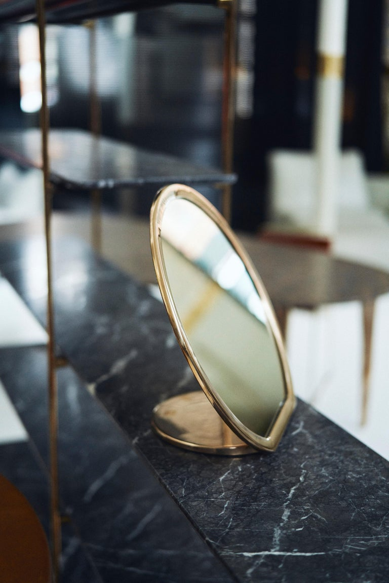 Designed by Daniel Barbera, the 'Bronze' make-up mirror is made from a sandcast solid bronze form that is hand finished to a smooth mirror polish, with the option of a satin or blackened bronze. Sculptural and minimal this mirror makes a create