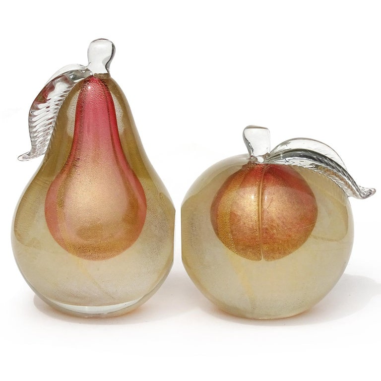 Beautiful vintage murano hand blown, Sommerso pink center with gold flecks Italian art glass pear and apple fruit bookends. Documented to designer Alfredo Barbini, circa 1950-1960. Published in his catalog. Each piece has 2 polished ends, so they