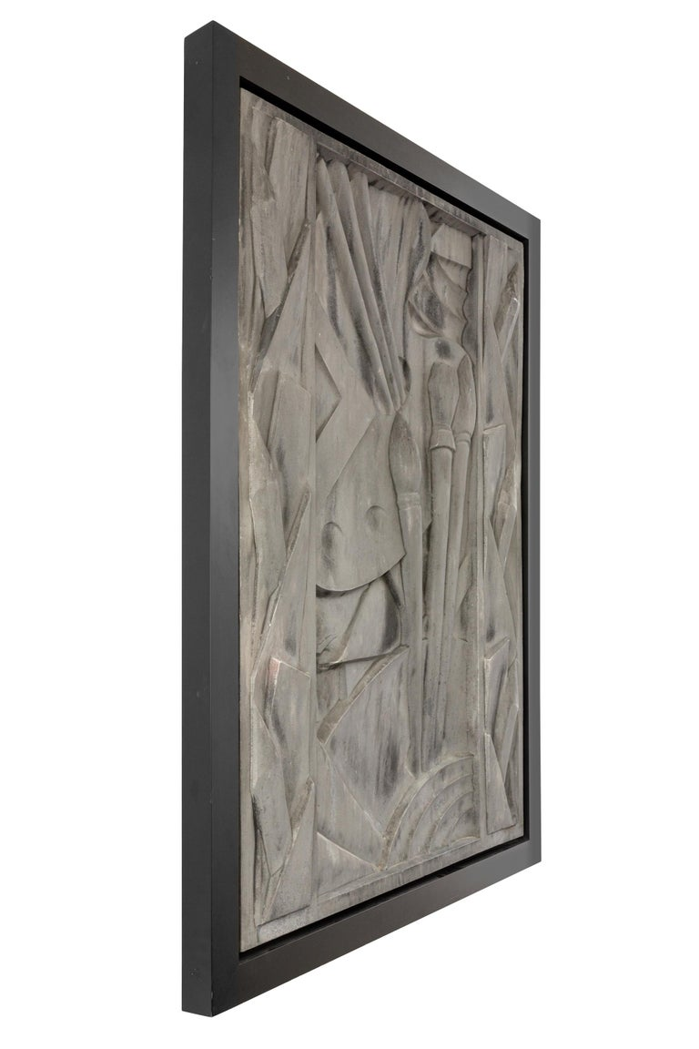 Cast aluminum relief depicting an artist's palette, brushes, pencils and charcoal sticks. Conceived to appeal to artists and musicians, the Barbizon Plaza was noted as the first music and art residence center in the United States. The list of