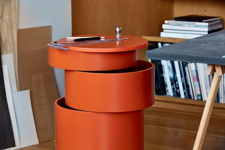 Adaptable side table and mobile storage unit in one. Comprised of four cylindrical parts of which two of the elements swing out to function as tables. Decorative chrome plated castors, limited