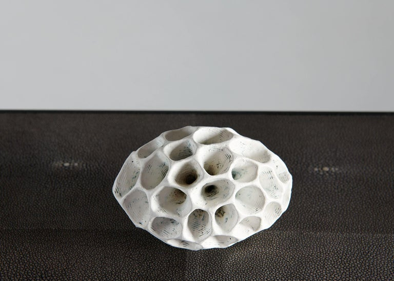 A°berg's works, made largely in black and white, are often purely sculptural, even playfully non-utilitarian. Rough surfaces inspired by geology are set in contrast to a refined elegance—new shapes inspired by fossils, old bones, or coral, forms
