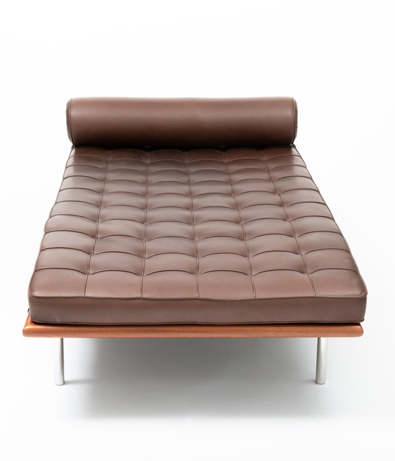 The Barcelona Chaise by Ludwig Mies van der Rohe in brown leather with tubular polished steel frame. In good used condition, very few and faint marks on frame and leather.