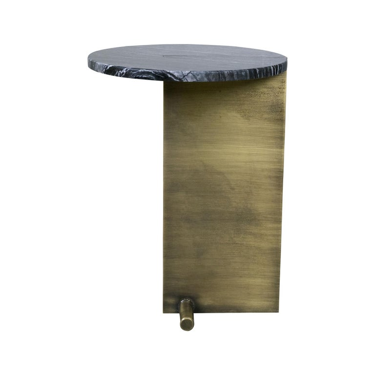 Side table with a round marble top mounted on a modern brass leg.  Marble: black, green or white Can be customized.