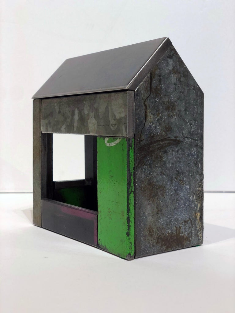 This is a welded steel sculpture made by furniture creator Jim Rose. It is sustainable design created from salvaged and recycled steel panels left over from his larger projects. These sculptures reference traditional American Folk Art barn house