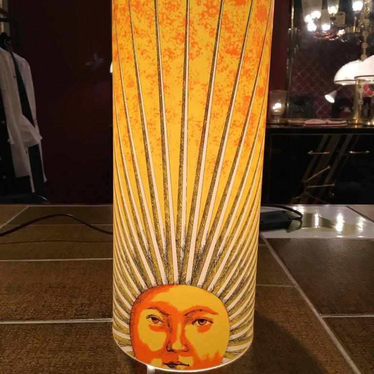 Barnaba Fornasetti, son of Piero Fornasetti design these beautifull tamble lamp for Antonangeli. Produce in the 1990 in Italy this is the model