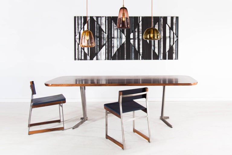 Inspired by op art and geometric textiles, the Barnet Table employs traditional marquetry techniques to merge furniture with painterly graphic images. Available in a variety of American hardwoods with surface patterns ranging from simple flat sawn