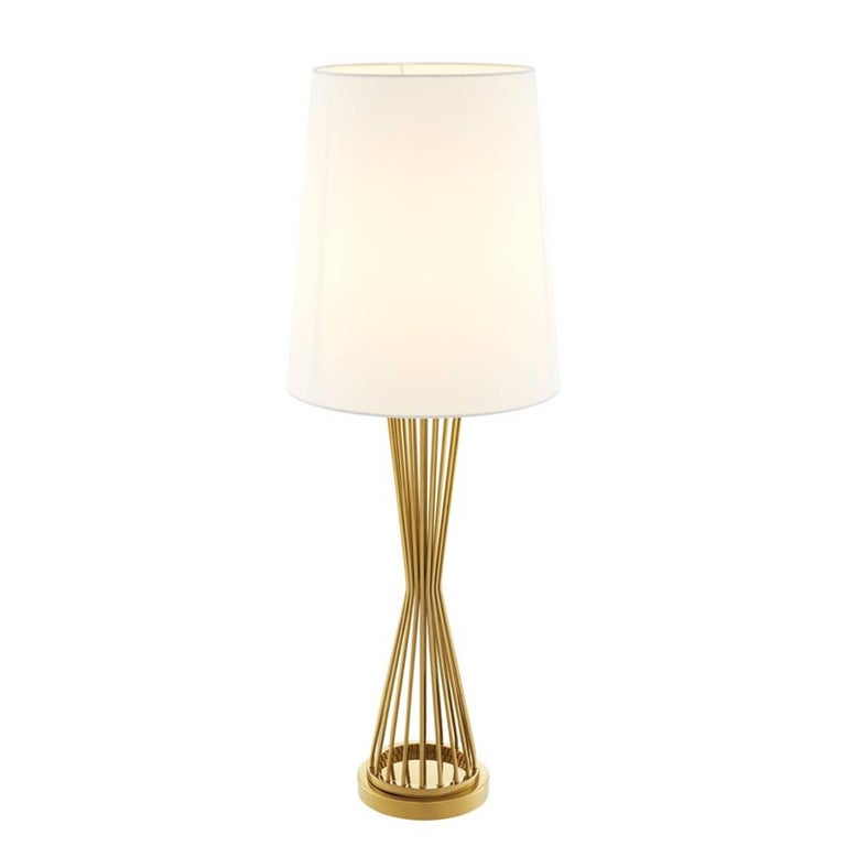Table lamp Barnet with base in gold finish. Off-white shade included. One bulb, lamp holder type E27, max 40 watt. Bulb not included. Also available in nickel finish. Also available in floor lamp Barnet.