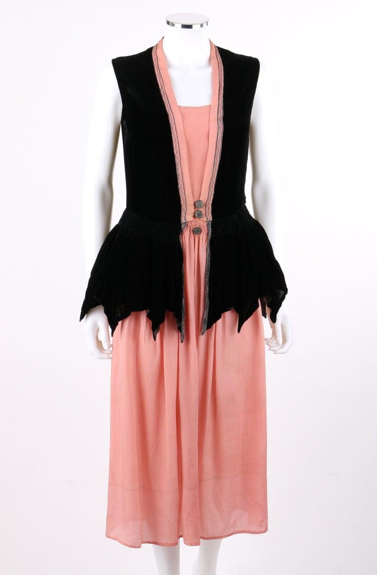 DESCRIPTION: BARNETT c.1910's Rose Pink & Black Silk Velvet Sleeveless Peplum Evening Dress    Circa: c.1910's Edwardian / 1920's Flapper Label(s): Barnett  Style: Peplum dress Color(s): Rose pink, black, and metallic blue Lined: No Marked Fabric