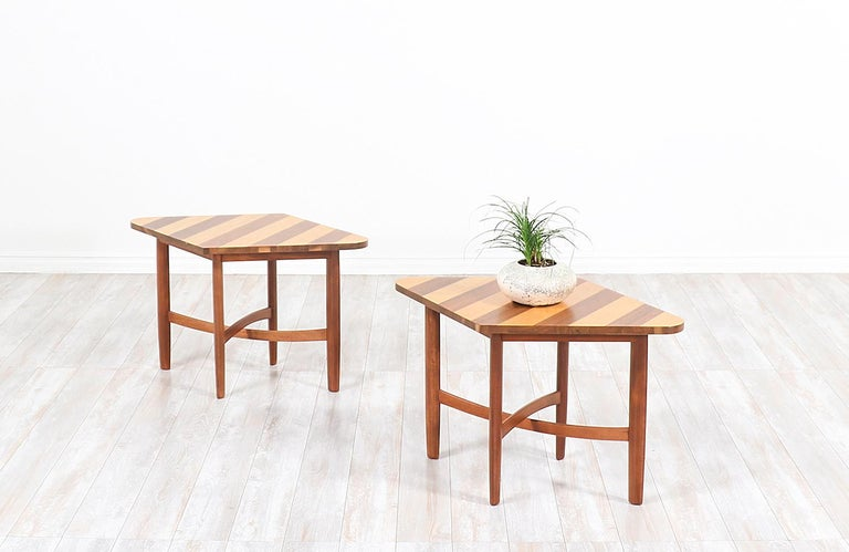 Stylish pair of side tables designed by Barney Flagg for Drexel's Parallel series and manufactured in the United States, circa 1960s. These rare and eye-catching design is constructed of walnut wood and birch wood with parallel stripes design on