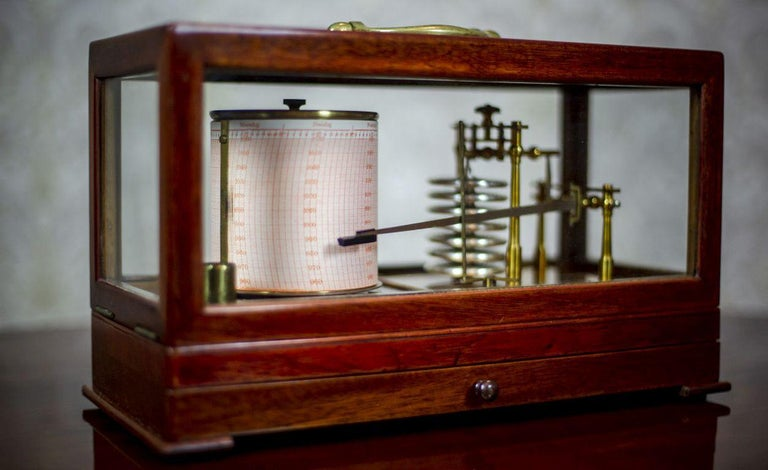 We present you a Sestrel barograph to measure atmospheric pressure.  This device registers changes in pressure by a pen on paper.  The results are saved on a special paper tape, placed on a rotating drum, which is turned on by a clock