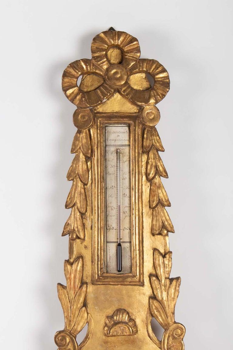 Louis XVI barometer in golden wood, 18th century Measures: H 91cm, W 28cm, W 5cm.