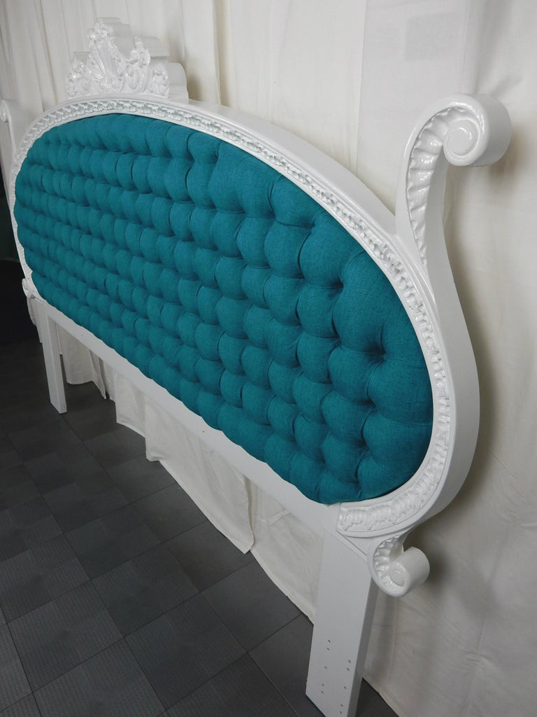 Phenomenal 1960s Hollywood Regency king size tufted headboard. In the style of Dorothy Draper covered in NEW teal blue silk upholstery/foam and creamy white gloss enamel over baroque carved wood. Bed frame mounting holes measure between 73-76