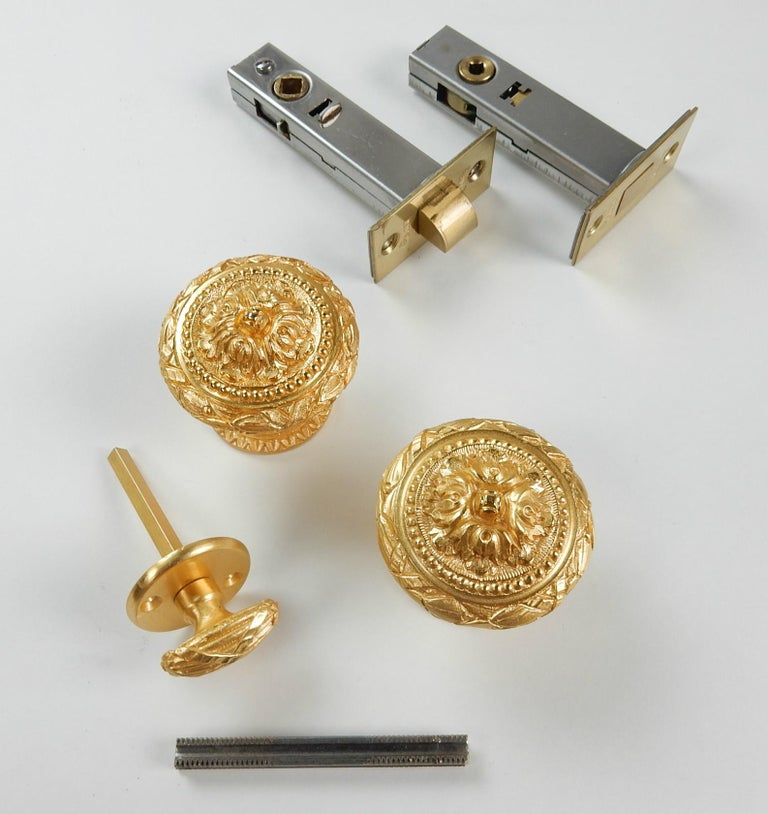 Gorgeous door knob and thumb bolt 22-karat gold plated set from the Sherle Wagner collection circa 1960s. This set includes 2 door knobs, thumb knob, threaded knob connector, side and deadbolt. All parts are clean and almost flawless as you can