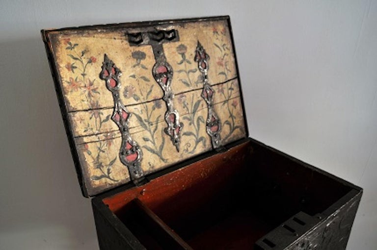 Norwegian Baroque box with interior paint on stand, origin: Norway, dated 1760 all original with beautiful, ornate pewter hardware  The exterior of the box is hand-carved including the date of 1760 which is surrounded by the coat of arms of