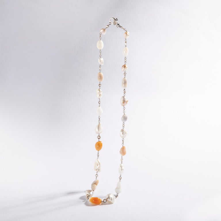 Baroque Culture Melo and White Pearl and Rose cut Diamond Necklace. White gold 18k. Natural Pearl color. Diamond Natural brown color.  Length: 18.50 inches (47.00 centimeters).  Former property of a French Lady.  We are reknown for curating
