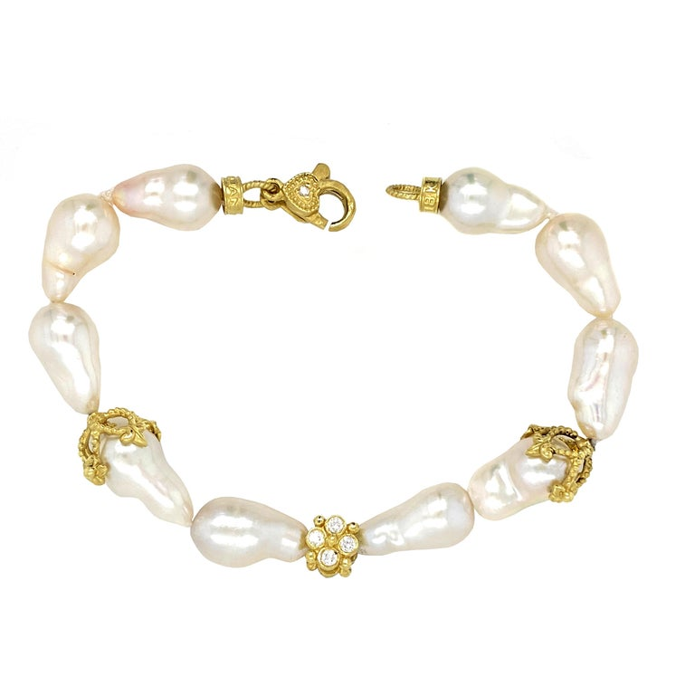18K Yellow Gold and Diamond Cluster Baroque Pearl Bracelet by Stambolian  This baroque pearl bracelet has touches of 18K yellow gold and also includes a double sided diamond cluster center set in yellow gold  Yellow gold and diamond lobster clasp