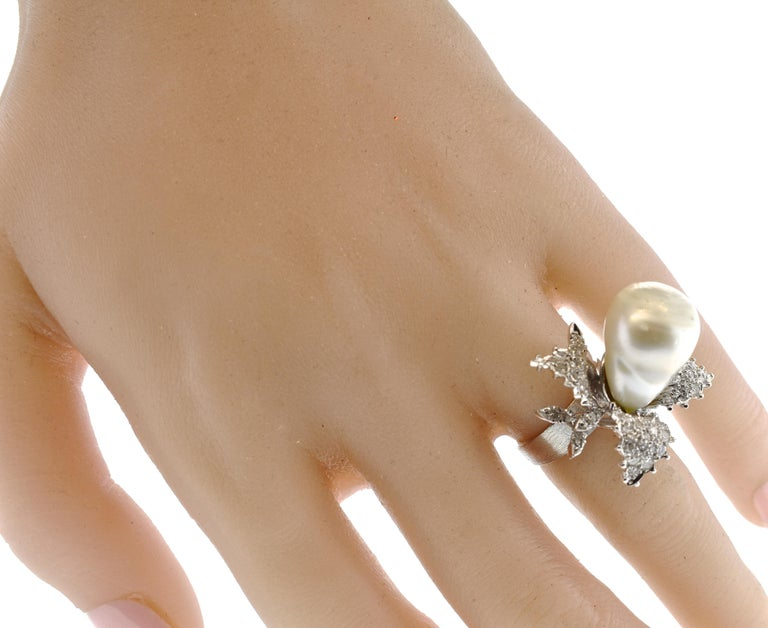 Baroque pearl set in and center and accented with over 50 white diamonds, pave set in the