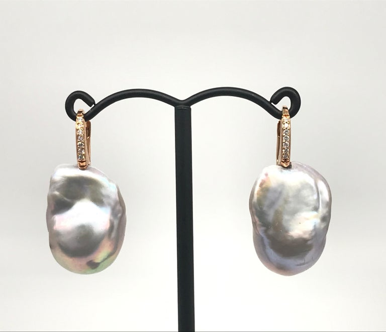 Rose Gold 18k with Diamonds and Baroque South of Seas Grey Pearls Drop Earrings Weight of Gold 2.60 grams 2 Baroque Pearls 14 White Diamonds 0.170 ct / Round Shape /  color G purity SI Rose Gold 18 k weight of gold 2.60 grams Can be adapted to ear
