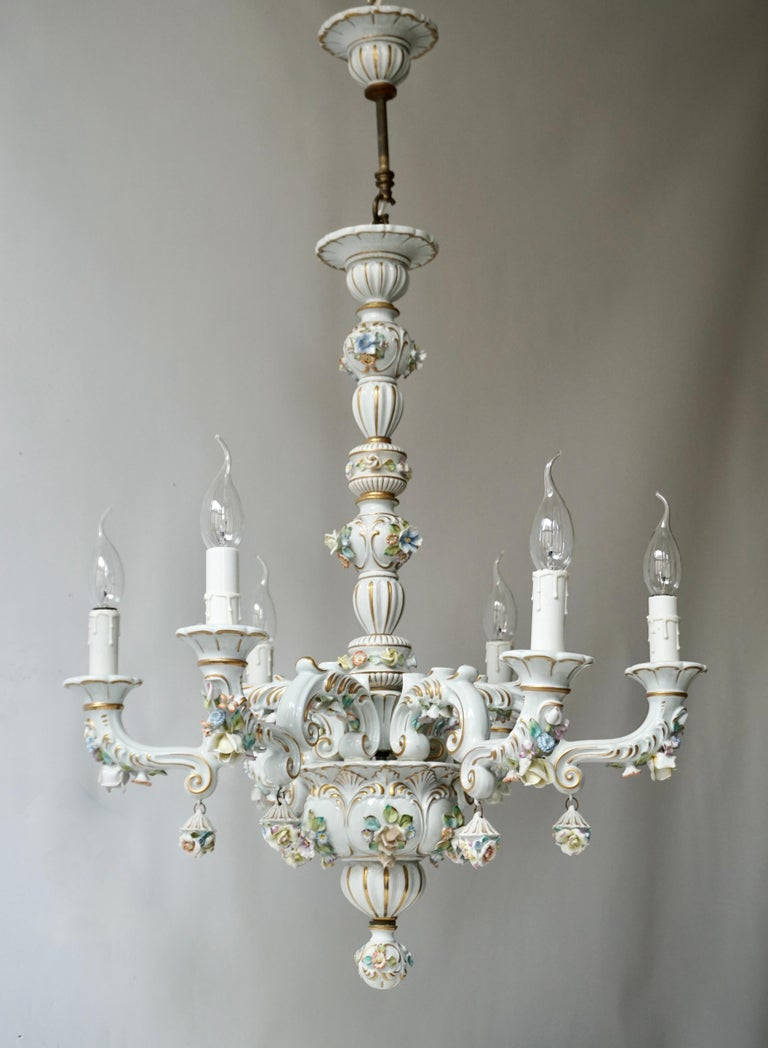 Exceptional quality Italian handmade porcelain chandelier.  Charming and very rare Italian work of art fully decorated with hand painted flowers.   Measures:  Diameter 57 cm. Height fixture 70 cm. Total height 88 m. Six light bulbs E14/ good