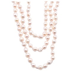 Baroque Seed Pearl Triple-Strand Necklace with 14 Karat Yellow Gold Clasp