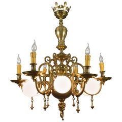 Baroque Style Brass and Bronze Twelve-Light Chandelier with Lion's Head Final