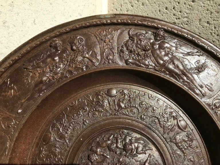 Large Berlin Iron Works cast iron charger with mythological figures of goddesses, putti, various animals and fish in relief. The central medallion with cartouches of the first six months of the year, January through June. The outer rim decorated