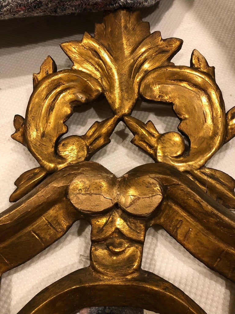 Baroque style mirror, France, 19th century, giltwood carved. The mirror is in original vintage condition and is not 100% clear.