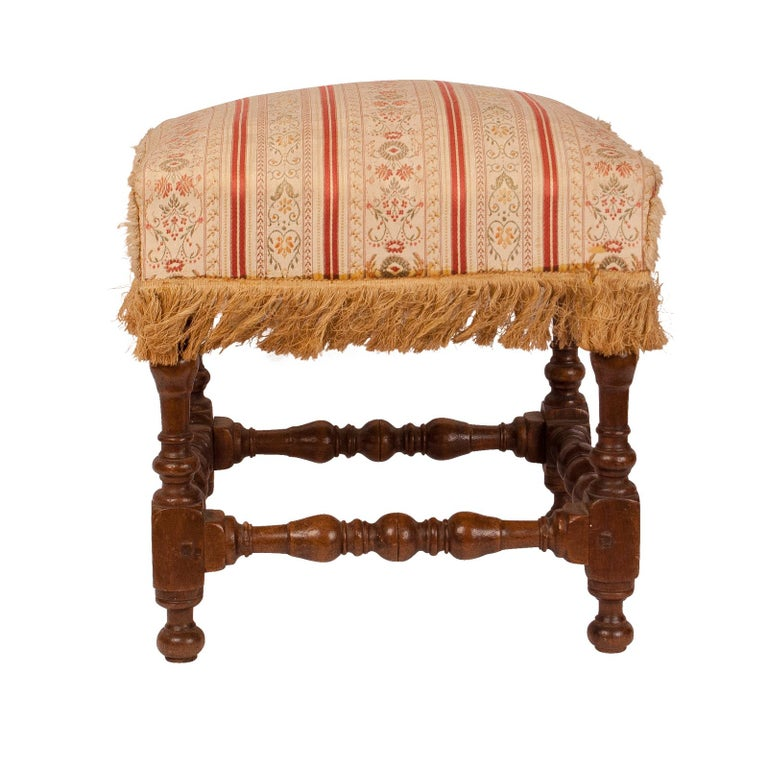 A mid-17th century walnut Baroque stool with turned legs. Spanish or Italian from a very good old collection.
