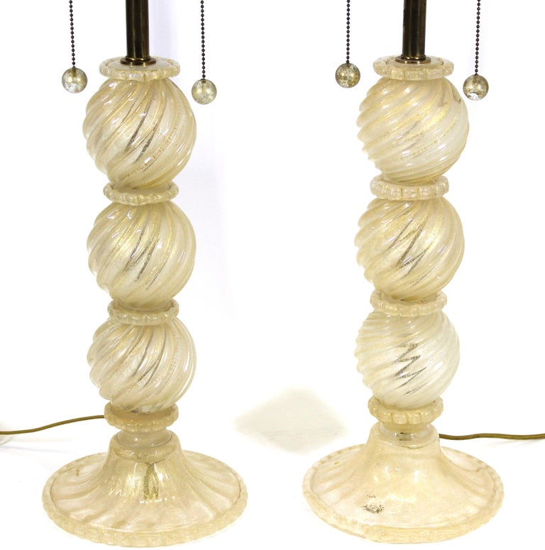 Barovier attributed pair of Italian Hollywood regency style Murano glass table lamps with gold-flecked glass.