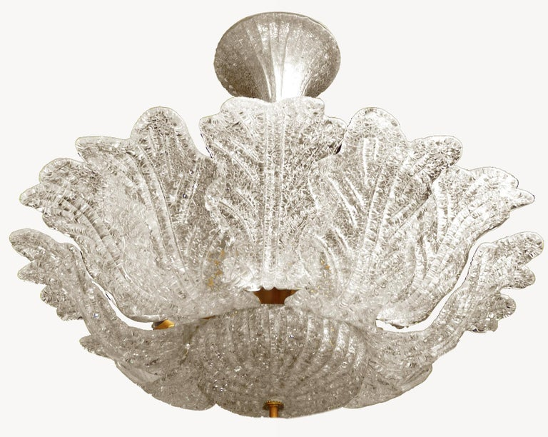 Gorgeous Italian Murano glass flush mount attributed to Barovier & Toso with hand blown textured glass Measures: Diameter 66 cm Height 66 cm Eight light bulbs E 14/ Good working condition. Weight - 12 Kg/ 28 lb. Assembly required. Bulbs not included.