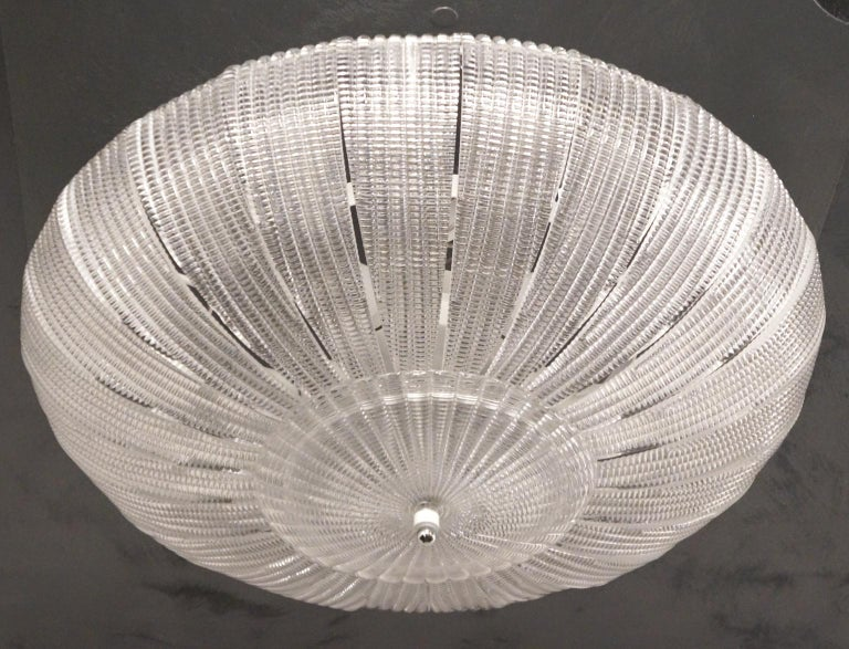 A very important ceiling lamp for its size that reaches a diameter of 85 cm (inches 33.46). Composed of 24 glass elements called