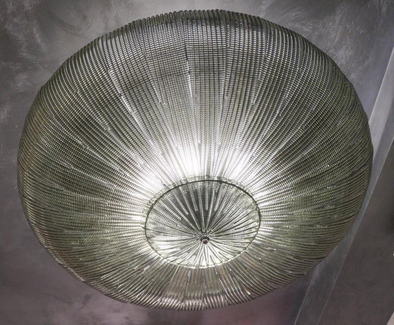 A very important ceiling lamp for its great size that reaches a diameter of 130 cm (inches 51.18). Composed of 32 glass elements called