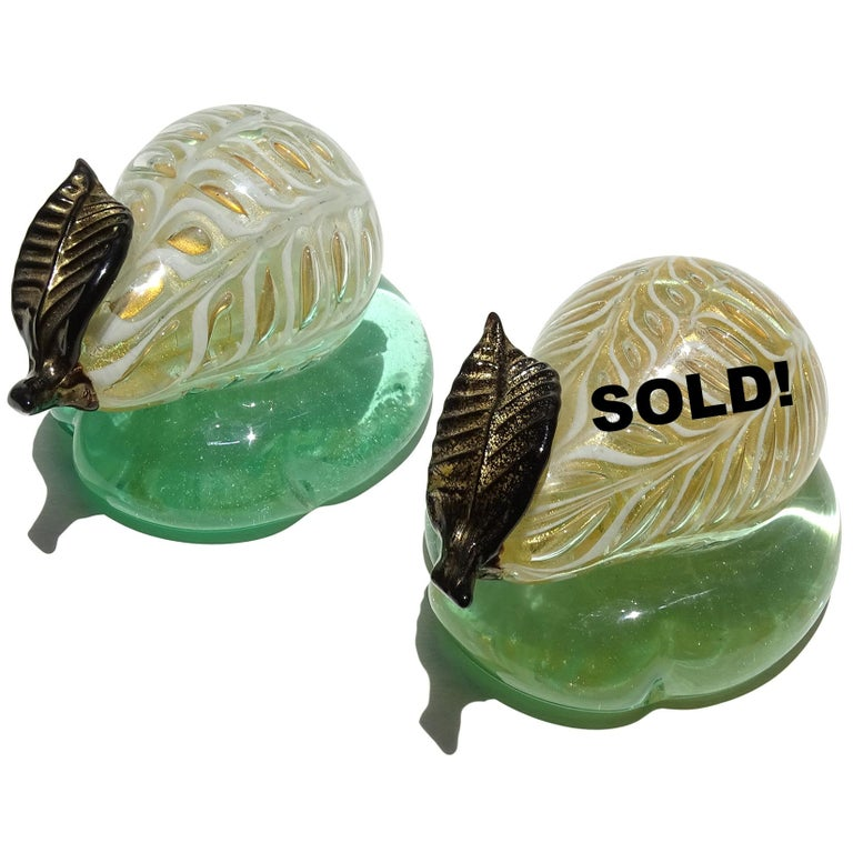Only 1 Left - Murano handblown white and gold flecks Italian art glass pear paperweight. Documented to the Barovier e Toso company. They are created in the Graffitto design, and stand on a green base. Also available in black (last photos), listing
