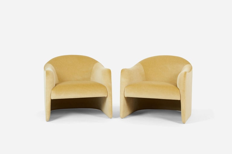 Barrel back lounge chairs, circa 1970. Fully restored with all new foam and striking gold mohair.