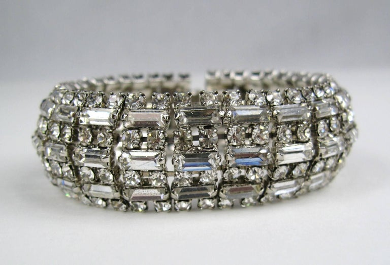 Stunning Wide Crystal Rhinestone Silver  Bracelet. Measuring .87 inches wide. Has a Slide-in clasp. 7.25 inches long to clasp. White Gilt Metal. This piece is unsigned, however, our client has attributed it Barrera. This is out of a massive