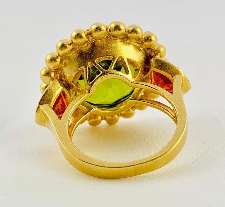 Artisan Barry Brinker 18 Karat Yellow Gold, Peridot and Sapphire Ladies Ring For Sale