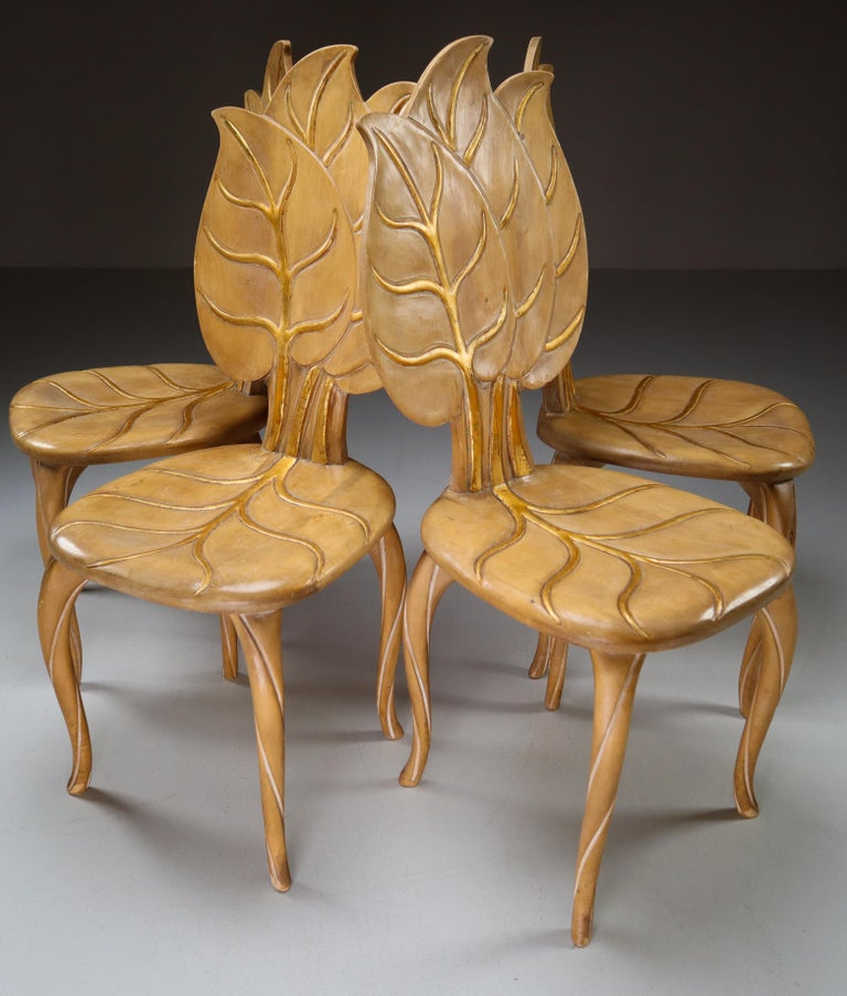 Set of four 1970s Bartolozzi & Maioli hand carved wooden leaf chair with original patina. These chairs would make an eye-catching addition to any interior such as living room, family room, screening room or hotel. It also perfectly fits in a