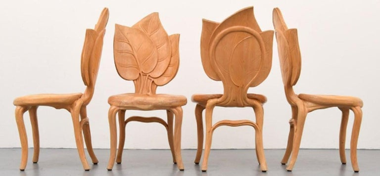 Vintage hand carved wooden leaf chairs by the Italian firm Bartolozzi & Maiolli. Beautifully carved wood dining chairs not a large production run. Florence, Italy, circa 1970s. Set of 8 dining room chairs. In very good condition.
