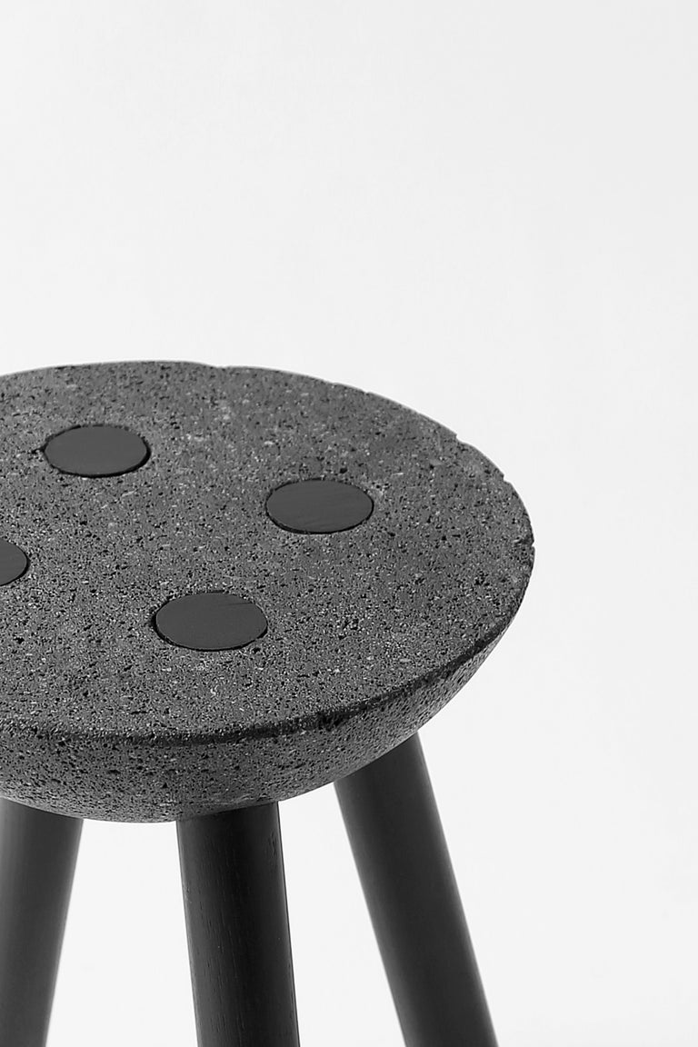 Designed by Panorámica, this petite stool is made of basalt and wooden legs with a basic construction. The beauty of this piece speaks for itself, acting as a clear expression of the artisan's desired effect: chic simplicity.  Made in Mexico.