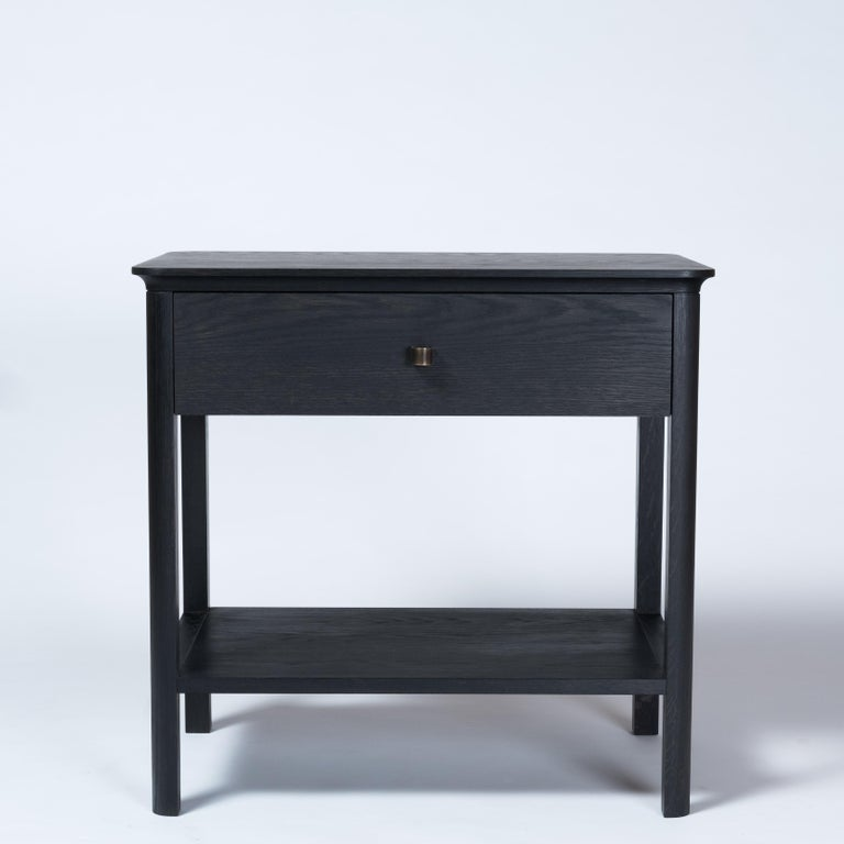 The Basin nightstand combines traditional construction with restrained and refined detailing. The table offers a myriad of uses from a nightstand to a side table. A dovetailed drawer offer concealed storage along with a shelf below. The custom made