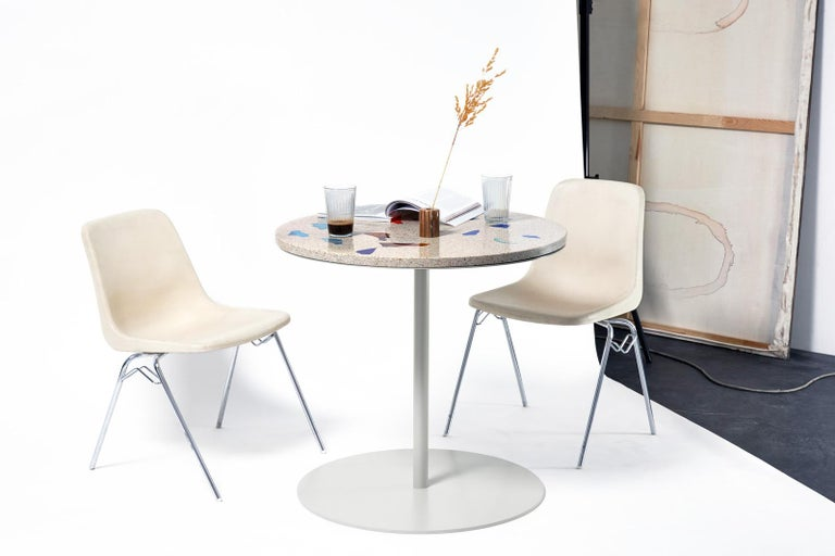 This round dining table is inspired by the typical Italian espresso bars of the '70s, but is an object of the present, always revealing new details. Available in four different color styles and with multiple customization options. The BSTR TBL is