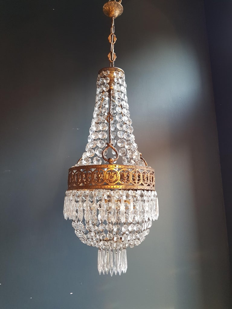 Original preserved chandelier, circa 1930. Cabling and sockets completely renewed. Crystal hand knotted Measures: Total height: 110 cm, height without chain: 78 cm, diameter 32 cm, weight (approximately) 8kg.  Number of lights: 4 -light Bulub