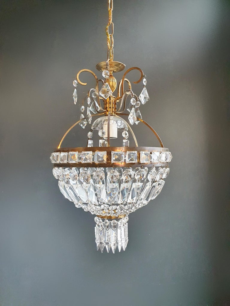 Cabling and sockets completely renewed. Crystal hand knotted Measures: Total height: 80 cm, height without chain: 50 cm, diameter 30 cm, weight (approximately) 4kg.  Number of lights: 1 -light Bulub sockets: E27 Brass frame. Total length