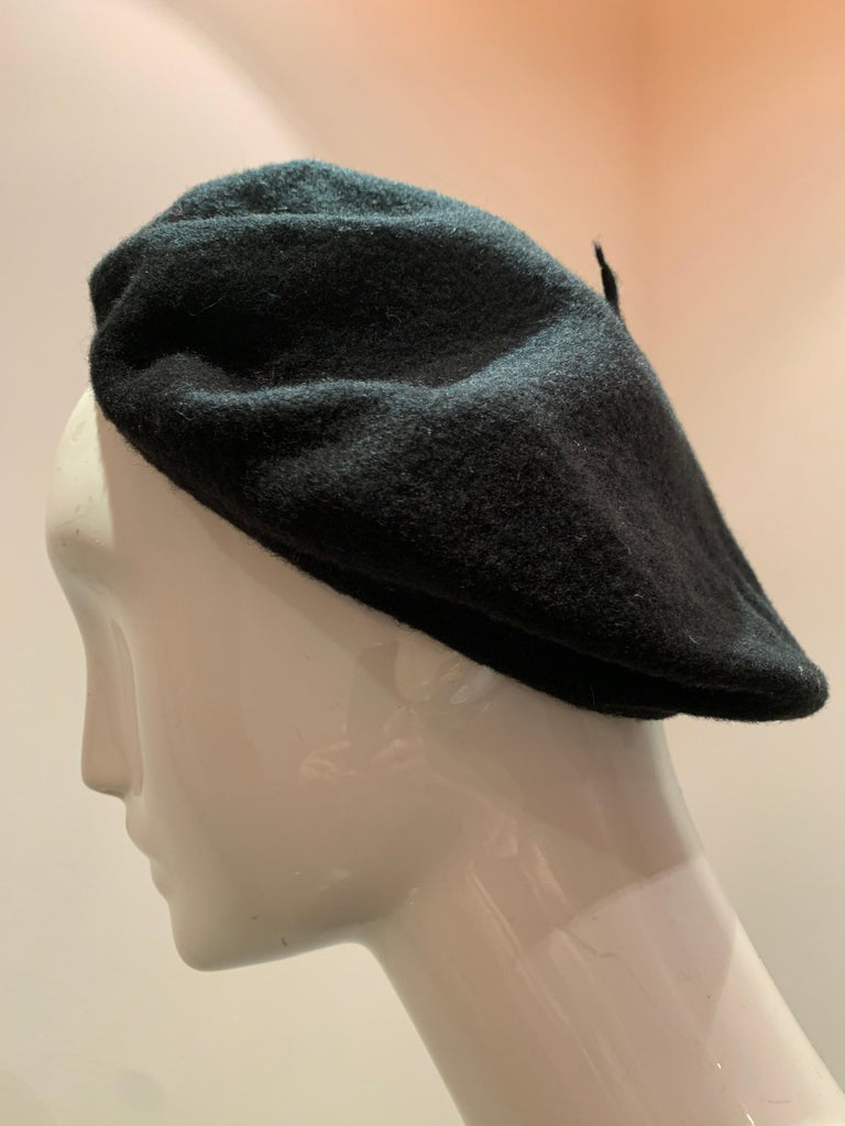 A sleek and simple classic:  A black felted wool beret made in France.